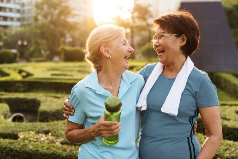 2 senior women exercising and laughing